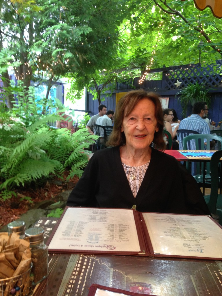 My mom in the garden of Cafe Santropol