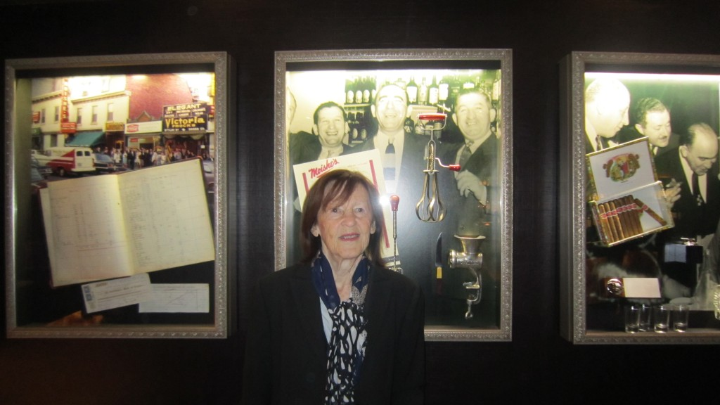 Mom at Moishe's Steakhouse, Montreal, 2014, in front of photograph of Moishe & Mr. Lotansky