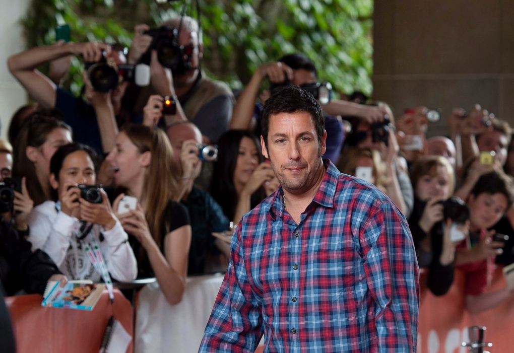 "Adam Sandler attended the premiere of Chris Rock's ""Top Five"" - here he is at the premier of ""Men, Women & Children."" Source:THE CANADIAN PRESS/Darren Calabrese"