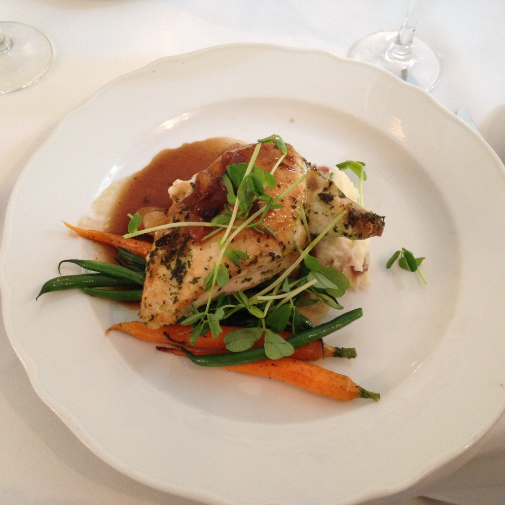 Main course: Pan seared herb chicken supreme, pinot noir jus, buttered French beans, baby carrots, lemon smashed red skin potatoes