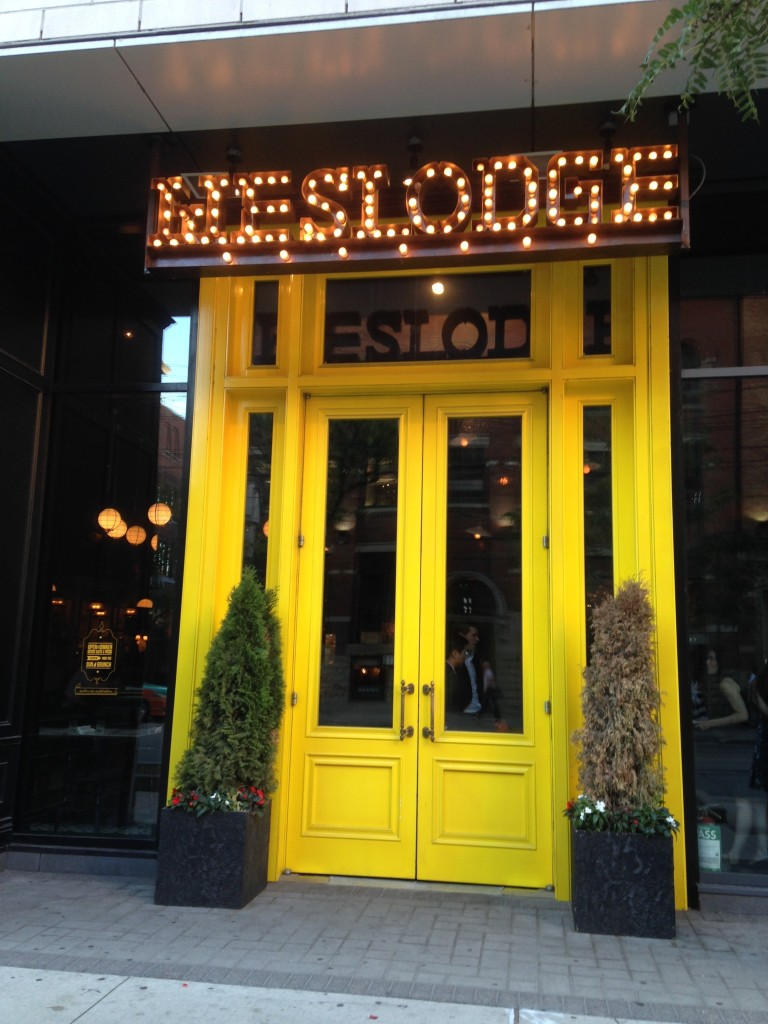 The unmistakable big yellow doors of the hip Weslodge Saloon