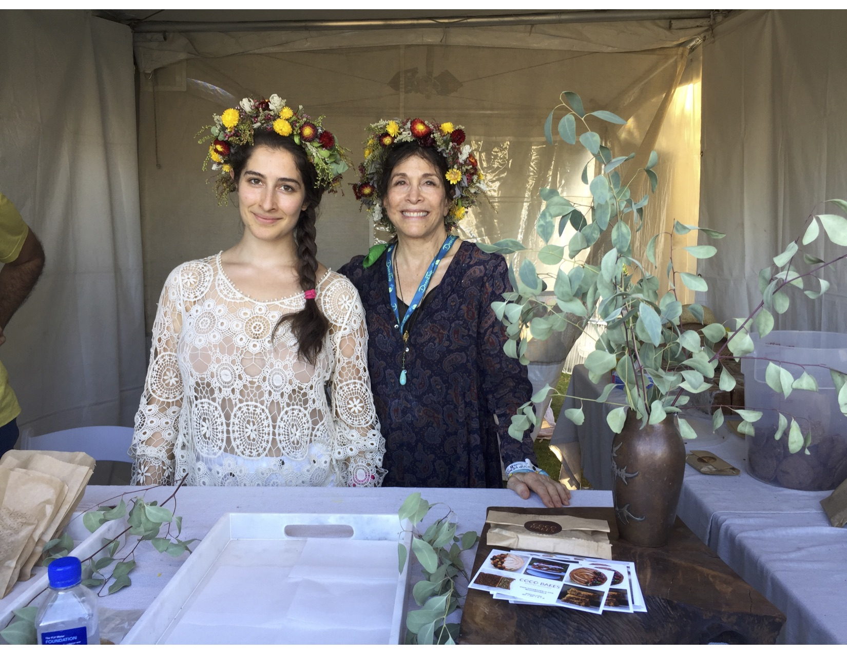 """If you're goin' to San Francisco, don't forget to wear some flowers in your hair..."" These two lovely ladies serving everyone their insanely delicious cookies!"